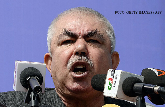 Afghan vice-presidential candidate Abdul Rahid Dostum, who is campaigning with presidential candidate Ashraf Ghani Ahmadzai, addresses the crowd during a gathering in the outskirts of Kunduz province, north of Kabul on March 19, 2014. Afghanistan