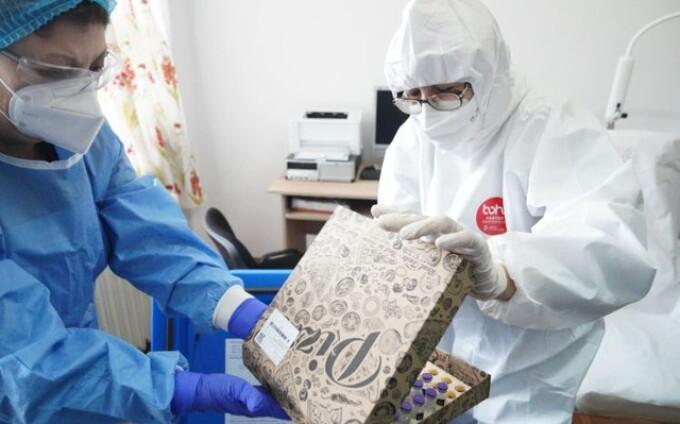 Vaccinul a fost distribuit în cutii de pizza