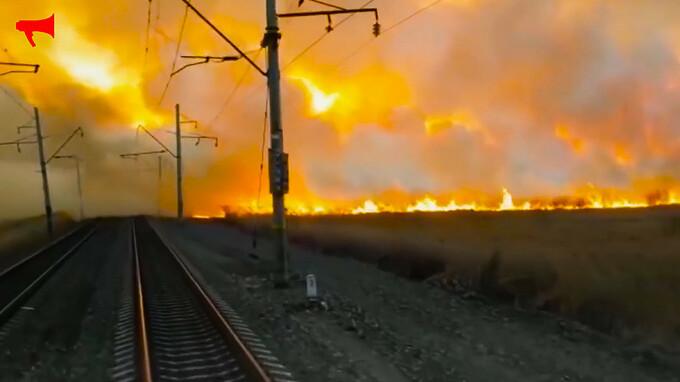 rusia, siberia, incendiu, tren,