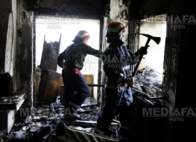 Femeia a fost descoperita in casa mistuita de foc