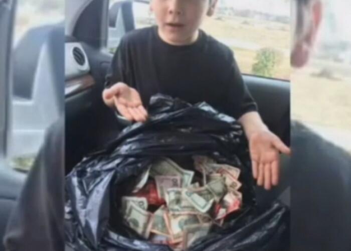 Un baiat de 7 ani a descoperit o geanta plina cu bani! Ce a facut dupa aceea este incredibil