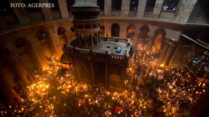 Lumina Sfanta de la Ierusalim a ajuns in Romania. Momentul in care s-a aprins a fost filmat