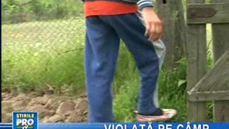 Tânără violată pe câmp
