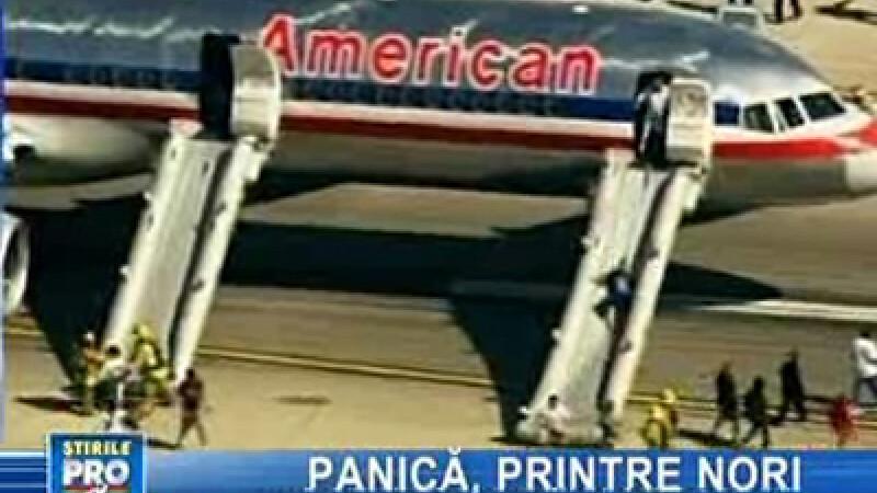 Pasagerii avionului, evacuaţi pe tobogane
