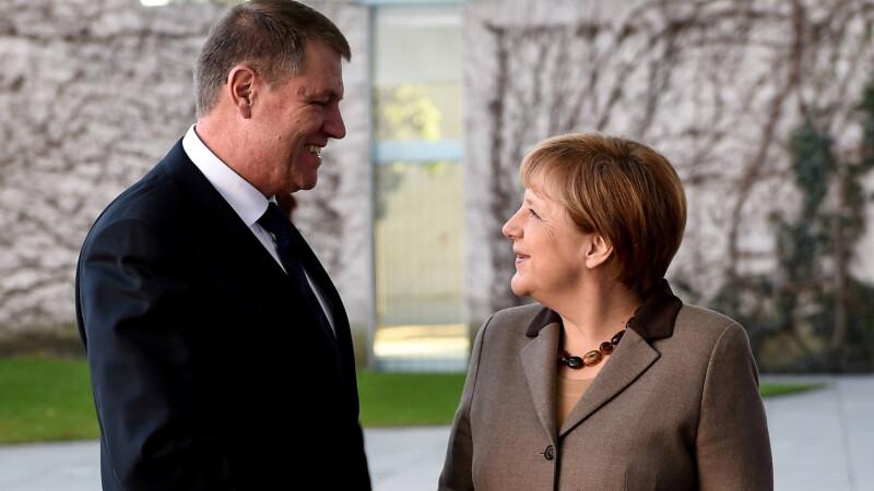 Iohannis pleacă în Germania. Președintele, la un eveniment alături de cancelarul Merkel