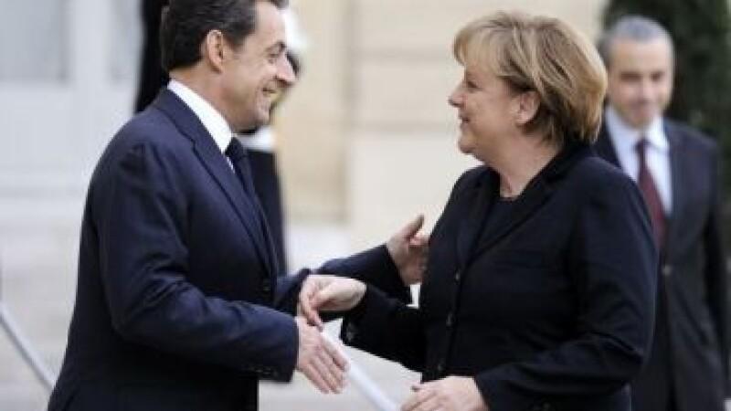 Sarkozy si Merkel