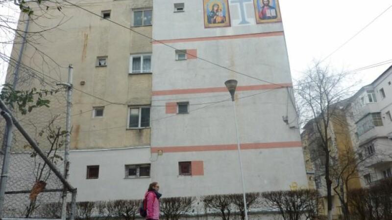 Un barbat din Botosani a pictat doua icoane uriase pe fatada blocului. Reactia preotilor din oras
