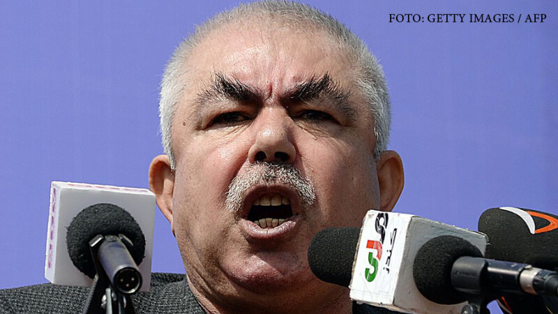 Afghan vice-presidential candidate Abdul Rahid Dostum, who is campaigning with presidential candidate Ashraf Ghani Ahmadzai, addresses the crowd during a gathering in the outskirts of Kunduz province, north of Kabul on March 19, 2014. Afghanistan's April