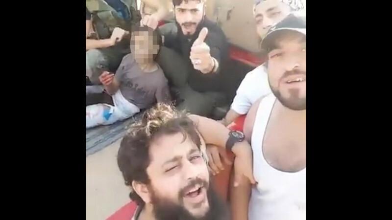 baiat decapitat de rebeli sirieni