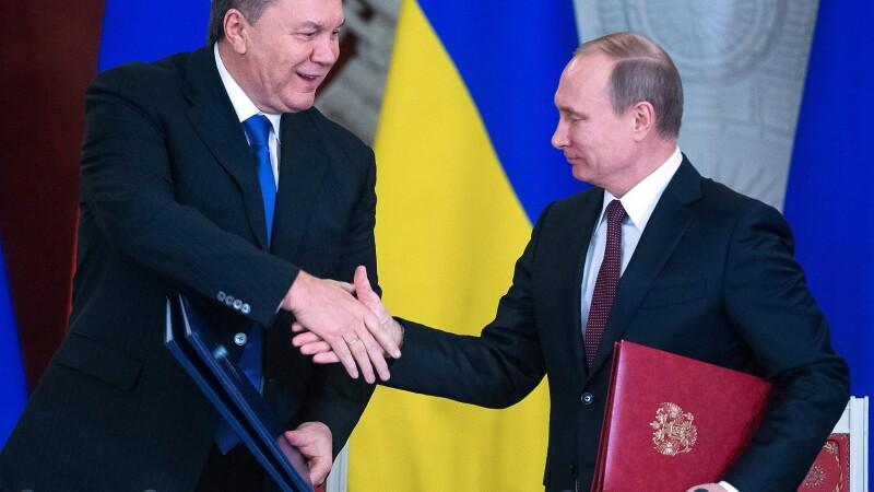 Viktor Ianukovici, Vladimir Putin - Getty