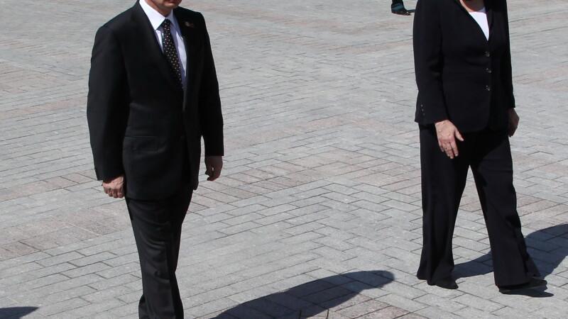 Angela Merkel, Vladimir Putin - GETTY