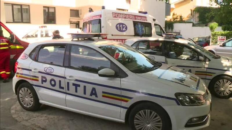 politie si ambulanta la locul crimei