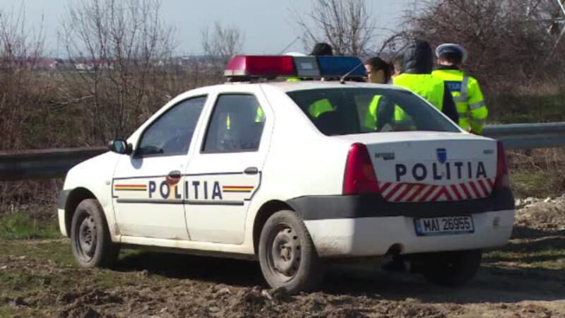 politisti ancheteaza o crima