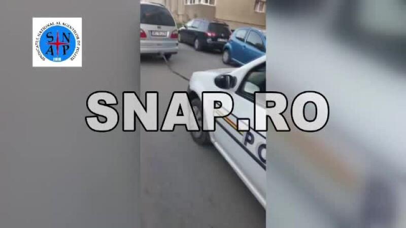politist cu masina tractata