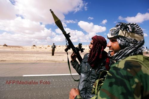 Insurgentii au patruns in Tripoli. Fiul lui Muammar Ghaddafi a fost capturat de rebeli