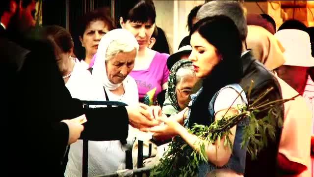 Mii de credinciosi au mers la biserica in Duminica Floriilor pentru rugaciune si o salcie sfintita