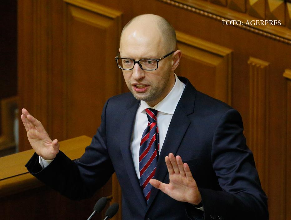 Premierul ucrainean demisioneaza. Presedintele, care apare in Panama Papers, il acuza de coruptie