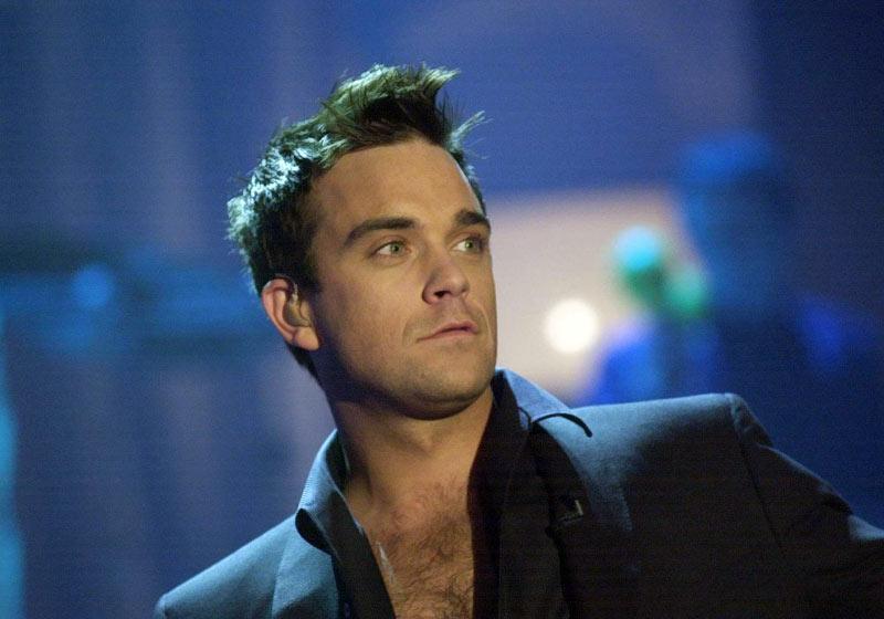 """Drama lui Robbie Williams. Isi injecteaza hormoni, pentru ca are """"libidoul unui om de 100 de ani"""