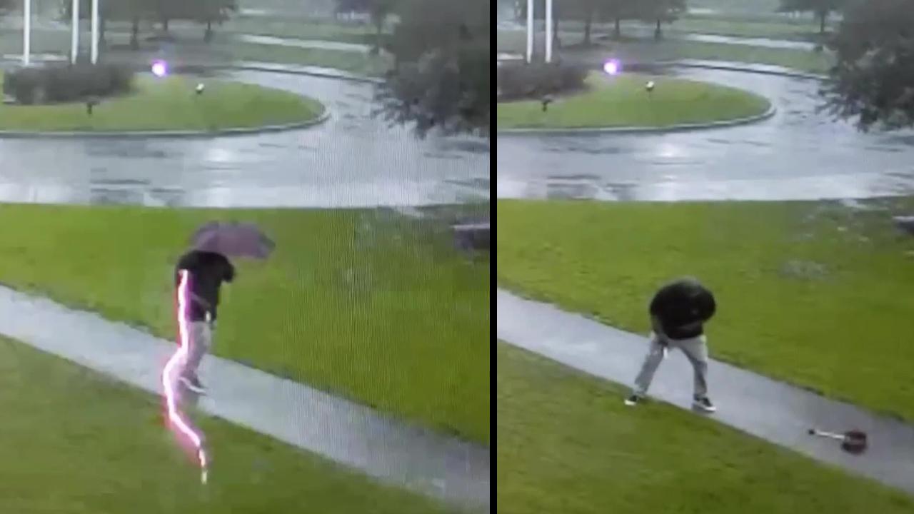 VIDEO. Un fulger lovește la câțiva centimetri de un bărbat, care avea o umbrelă în mână