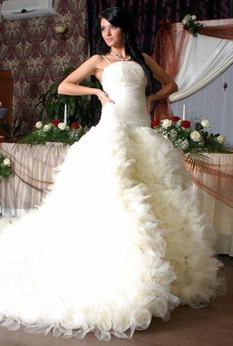 Kate Middleton ar putea imbraca o rochie de mireasa creata de un roman
