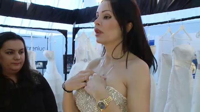 Brigitte Sfat se pregateste de nunta cu Ilie Nastase. A probat deja o rochie de mireasa