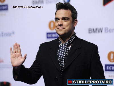 Aroganta sau prostie? Unul dintre cei mai bogati artisti din lume, Robbie Williams, vrea in comunism