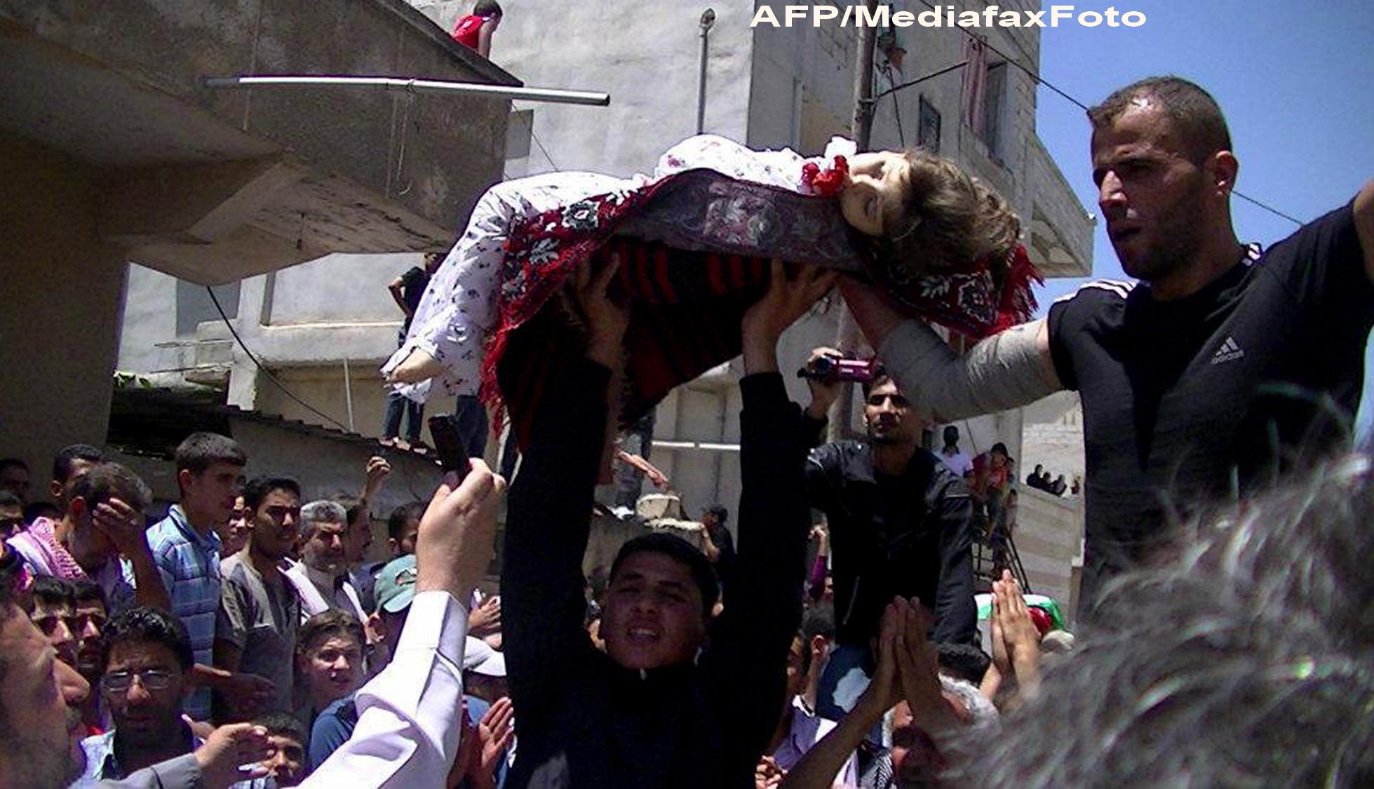 ATENTIE, IMAGINI SOCANTE. O bomba explodeaza chiar in timpul unei inmormantari in Siria