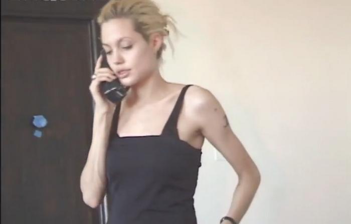 O filmare cu Angelina Jolie din perioada in care ar fi fost dependenta de heroina, facuta publica in premiera. VIDEO