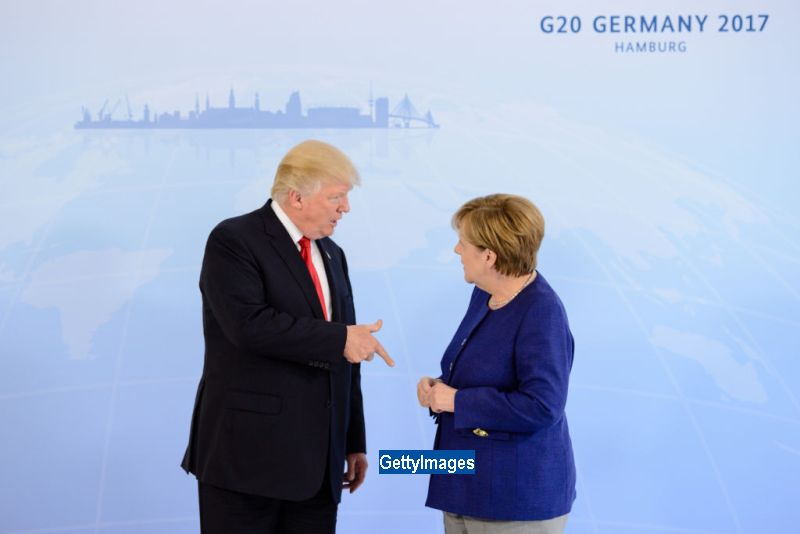 Donald Trump si Angela Merkel, intalnire inainte de Summit-ul G20 de la Hamburg. De ce au ezitat sa dea mana cei doi lideri