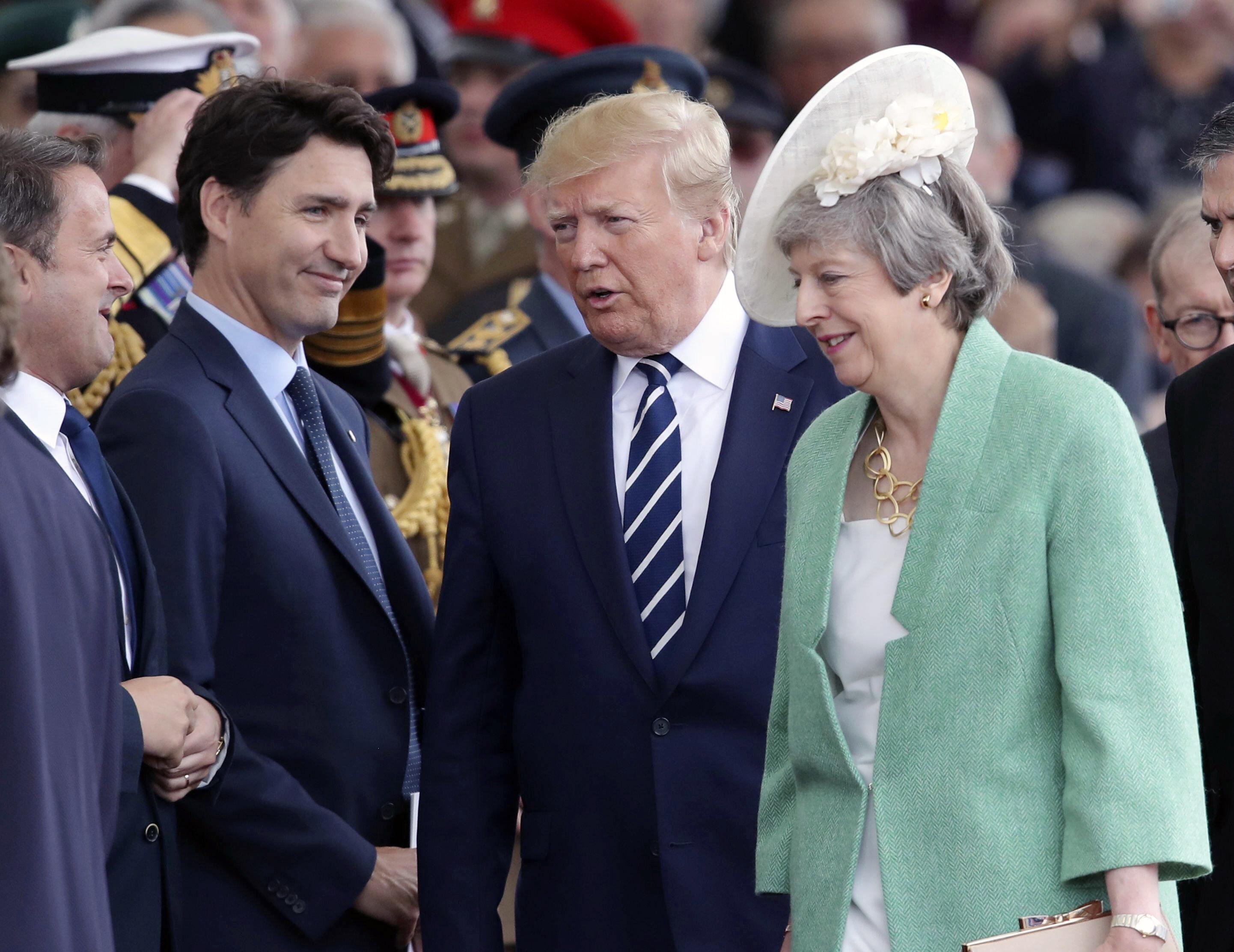 Afirmațiile rasiste ale lui Trump, criticate de premierul Canadei și Theresa May