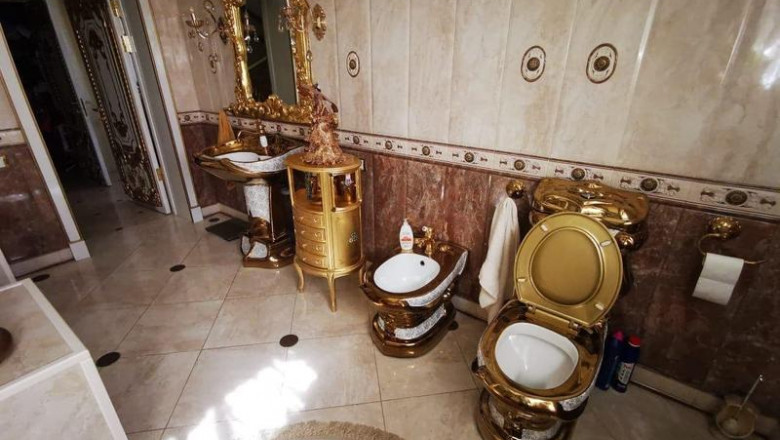 Un polițist rus, acuzat de corupție, trăiește într-un palat și are toaleta suflată cu aur. VIDEO