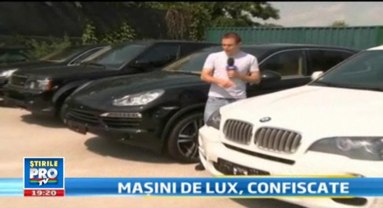 Au venit cu o Dacie Logan si au plecat cu BMW, Porsche si Range Rover. Lovitura Garzii Financiare