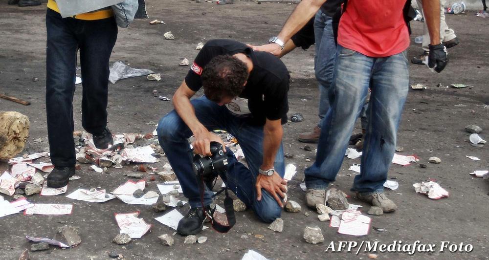 Razboiul de la Euro 2012. Fotoreporter roman, internat dupa ce a fost atacat si talharit in Ucraina