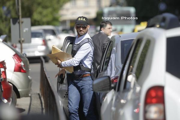 Dosarul CFR Marfa: 21 de persoane retinute, intre care un fost director. 73.900 lei, 15.800 euro si 21.600 dolari, ridicati
