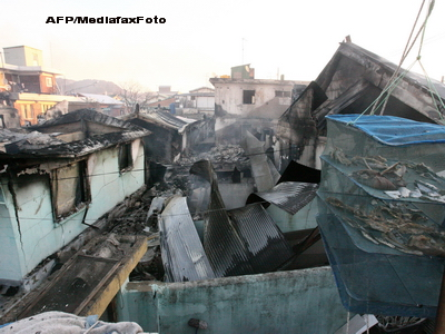 Case distruse, obuze si frica: prima zi de razboi coreean, in fotografii!