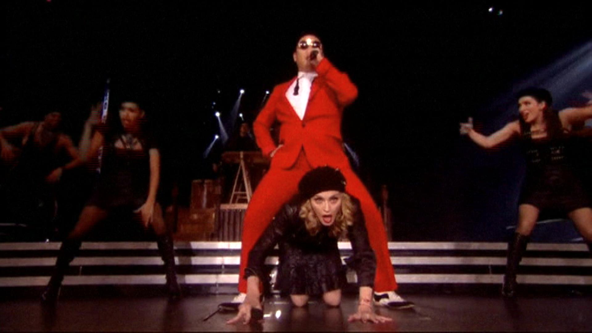 Madonna a fost calarita de PSY pe ritmurile