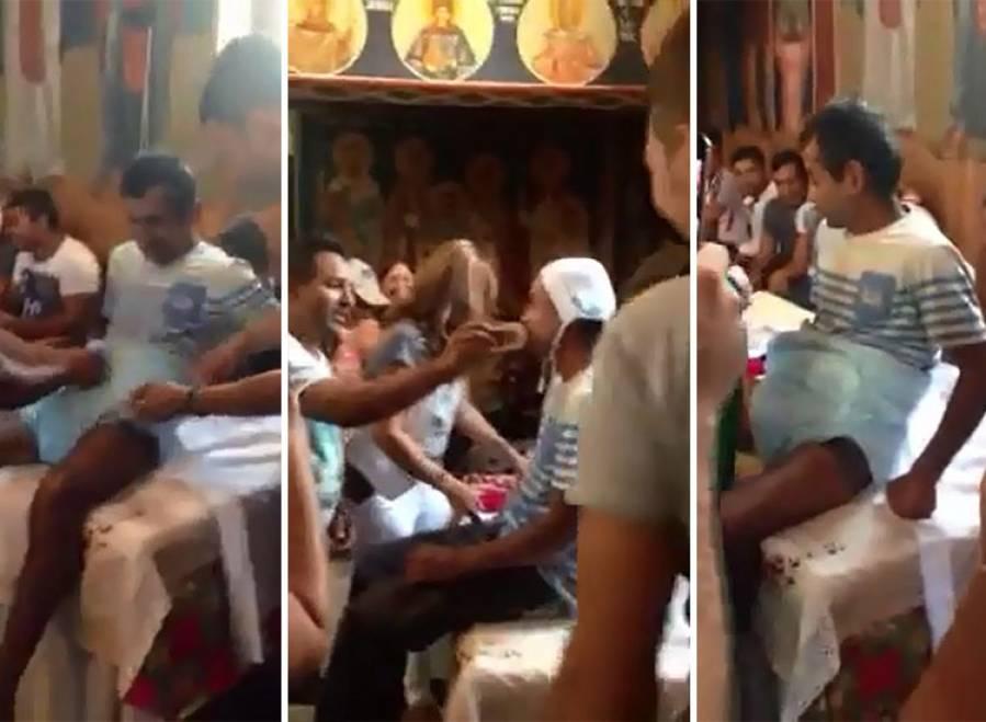 Inregistrare scandaloasa intr-o biserica din Romania in timp ce un barbat de etnie roma era botezat
