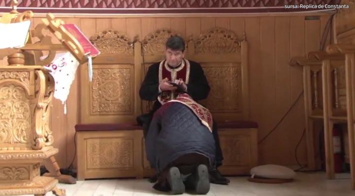 Preotul care butona telefonul în timp ce spovedea ridică un bloc cu 7 etaje în Mamaia. Ce afaceri are slujitorul Domnului